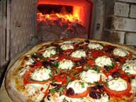 600_pizza_in_front_of_oven_2